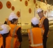 Minister Finlayson talking with school pupils at the Arras Tunnel