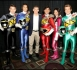 Group of actors wearing Power Rangers costumes