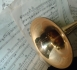 Brass instrument on top on sheet music