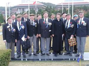 """Then-Prime Minister Helen Clark with veterans in 2005<p class=""""detail-small"""">Image courtesy of the Ministry of Foreign Affairs and Trade</p>"""