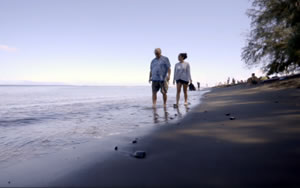 Man and younger woman on beach